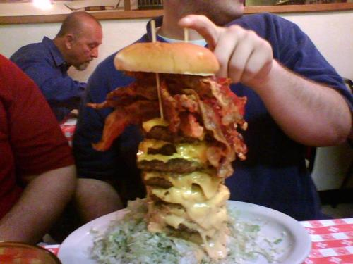 This burger, (a real menu item at Mel's Country Cafe in Tomball, Texas) consists of five pounds of beef, one pound of bacon and a quarter pound of cheese. This would not be on the menu for Eating Better Forever.